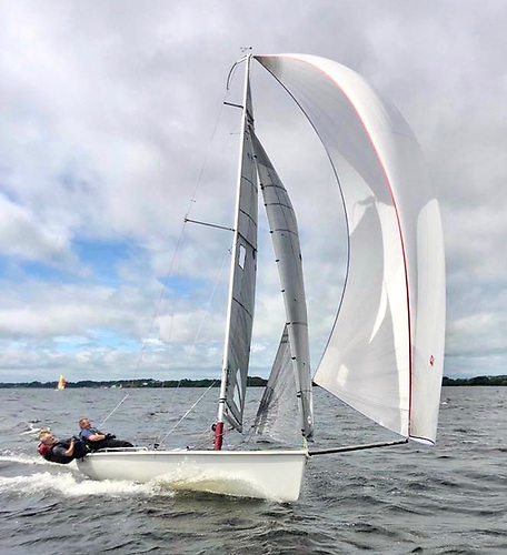The SB20 Bango on the way to success at Lough Ree's Quarter Millennial, with junior champion Ben Graf on helm, LRYC Commodore John McGonigle at middle, and owner Kevin Fenton forward. Photo: Alex Hobbs