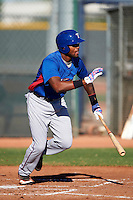 Texas Rangers minor league outfielder Jordan Akins #8 during an instructional league game against a Korean All-Star team at the Surprise Stadium Complex on October 13, 2012 in Surprise, Arizona.  (Mike Janes/Four Seam Images)