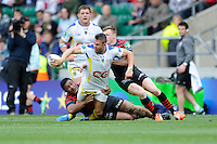 Lee Byrne of ASM Clermont Auvergne looks to offload in the tackle during the Heineken Cup semi-final match between Saracens and ASM Clermont Auvergne at Twickenham Stadium on Saturday 26th April 2014 (Photo by Rob Munro)