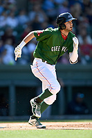 Designated hitter C.J. Chatham (10) of the Greenville Drive runs out a batted ball in a game against the Charleston RiverDogs on Sunday, April 29, 2018, at Fluor Field at the West End in Greenville, South Carolina. Greenville won, 2-0. (Tom Priddy/Four Seam Images)