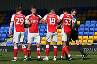 The Fleetwood defensive wall of Gerard Garner, Callum Connolly, Kyle Vassell and James Hill are urged to move further away from the ball by referee Peter Wright during AFC Wimbledon vs Fleetwood Town, Sky Bet EFL League 1 Football at Plough Lane on 5th April 2021