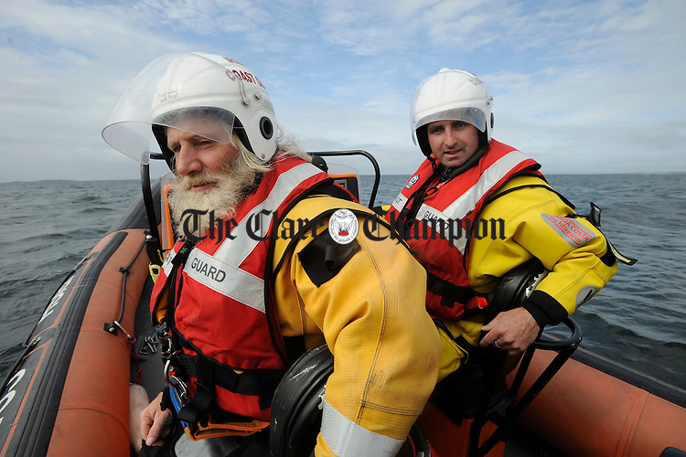 Tom Doherty, Deputy Area Officer with the Doolin Unit of the Irish Coastguard and crewman Martoni Vaughan, co-ordinating the safety of all competitors at the Leon Currach Regatta at Seafield, Quilty. Photograph by John Kelly.