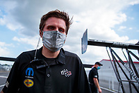 Jul 10, 2020; Clermont, Indiana, USA; Crew member for NHRA top fuel driver Leah Pruett during testing for the Lucas Oil Nationals at Lucas Oil Raceway. This will be the first race back for NHRA since the COVID-19 pandemic. Mandatory Credit: Mark J. Rebilas-USA TODAY Sports