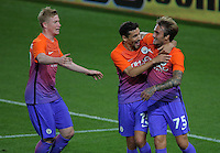 Aleix Garcia of Manchester City (R) celebrates his goal with team mates Jesus Navas and Kevin De Bruyne during the EFL Cup Third Round match between Swansea City and Manchester City at The Liberty Stadium in Swansea, Wales, UK. Wednesday 21 September.