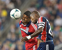 Chicago Fire substitute forward Quincy Amarikwa (24) and New England Revolution defender Jose Goncalves (23) battle for head ball.  In a Major League Soccer (MLS) match, the New England Revolution (blue) defeated Chicago Fire (red), 2-0, at Gillette Stadium on August 17, 2013.