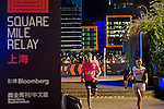 Runners participate at the Bloomberg Square Mile Relay near the Huangpu River in Shanghai, China.  Photo by Lucas Schifres / Power Sport Images