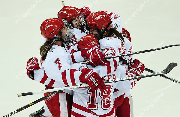 The Badgers celebrate a second period goal by Hilary Knight (23), as the Wisconsin women's hockey team tops Minnesota-Duluth 2-1 to advance to the Frozen Four on Saturday, 3/12/11, at the Kohl Center in Madison, Wisconsin | Photo by Greg Dixon accompanied article by Andy Baggot in the Wisconsin State Journal and on-line at http://j.mp/hsKrEL