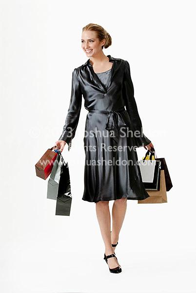Young woman walking, carrying shopping bags
