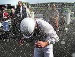 Jerry LaSala is doused with champaign from fellow jockeys including Randall Meier after LaSala ran his last race as a jockey Saturday at Arlington Park.