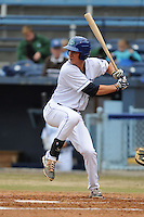 Asheville Tourists designated hitter Jordan Patterson #10 swings at a pitch during game one of a double header against the West Virginia Power at McCormick Field on April 8, 2014 in Asheville, North Carolina. The Power defeated the Tourists 6-5. (Tony Farlow/Four Seam Images)
