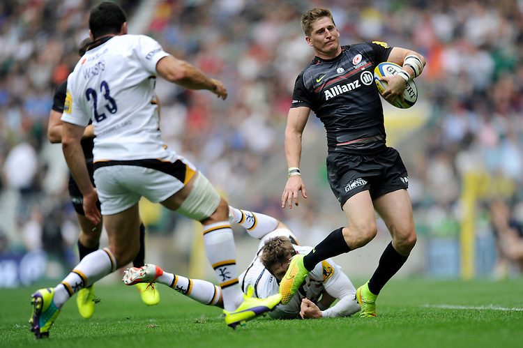 David Strettle of Saracens in action during the Premiership Rugby Round 1 match between Saracens and Wasps at Twickenham Stadium on Saturday 6th September 2014 (Photo by Rob Munro)
