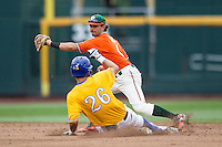 Miami Hurricanes second baseman Johnny Ruiz (4) starts to tag UC Santa Barbara Gauchos baserunner Billy Fredrick (26) slides into second during Game 5 of the NCAA College World Series on June 20, 2016 at TD Ameritrade Park in Omaha, Nebraska. UC Santa Barbara defeated Miami  5-3. (Andrew Woolley/Four Seam Images)
