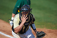 UCF Knights catcher Matt Diorio (14) looks for a wild pitch during a game against the Siena Saints on February 21, 2016 at Jay Bergman Field in Orlando, Florida.  UCF defeated Siena 11-2.  (Mike Janes/Four Seam Images)