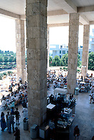 Richard Meier: The Getty Center. Looking over railing to Museum Cafe below and garden beyond.  Photo '99.