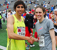 The top male and female runners, Jeff Jonaitis and Gwen Jorgensen, congratulate each other at the Crazylegs Classic on Saturday, 4/24/10, in Madison, Wisconsin