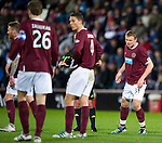 Hearts v St Johnstone...03.12.11   SPL .Ref Stevie O'Reilly separates team mates Ryan Stevenson and Adrian Mrowiec who were arguing with each other.Picture by Graeme Hart..Copyright Perthshire Picture Agency.Tel: 01738 623350  Mobile: 07990 594431