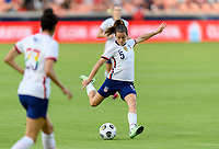 HOUSTON, TX - JUNE 10: Kelley O'Hara #5 of the United States takes a shot at the Portugal goal during a game between Portugal and USWNT at BBVA Stadium on June 10, 2021 in Houston, Texas.