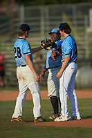 Dry Pond Blue Sox first baseman Derek Farley (40) (SouthLake Christian HS) touches gloves with third baseman Kai Henson (28) (Mt Island Charter HS) as starting pitcher Garrett Lynch (7) (Hopewell HS) looks on during the game against the Mooresville Spinners at Moor Park on July 2, 2020 in Mooresville, NC.  The Spinners defeated the Blue Sox 9-4. (Brian Westerholt/Four Seam Images)
