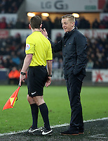 SWANSEA, WALES - MARCH 16: Swansea manager Garry Monk (R) protests to the assistant referee during the Premier League match between Swansea City and Liverpool at the Liberty Stadium on March 16, 2015 in Swansea, Wales
