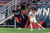 FOXBOROUGH, MA - AUGUST 5: Josh Coan #17 of North Carolina FC passes the ball as Damian Rivera #72 of New England Revolution II closes during a game between North Carolina FC and New England Revolution II at Gillette Stadium on August 5, 2021 in Foxborough, Massachusetts.