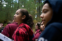 Harony Segura, 10, (left) Carolyn Francisco, 11, (center) and Yancee Goris, 12, (right) and sixth grade other students from Roger Williams Middle School in Providence, Rhode Island, walk along a trail at the Powder Mill Ledges Wildlife Refuge in Smithfield, Rhode Island, on Oct. 20, 2011. The students are part of the EcoExplorer program run by the Providence After School Alliance, which helps to kids in learning environments outside of school time.  <br /> The students make a weekly visit to the refuge, operated by the Rhode Island Audubon Society, to learn about nature and ecology.<br /> <br /> <br /> M. Scott Brauer for Education Week