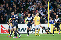 MELBOURNE, AUSTRALIA - NOVEMBER 18: Carlos Hernandez of the Victory celebrates his goal with Kevin Muscat during the round 14 A-League match between the Melbourne Victory and Central Coast Mariners at AAMI Park on November 18, 2010 in Melbourne, Australia (Photo by Sydney Low / Asterisk Images)