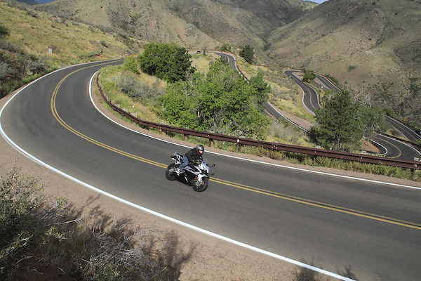 Motorcycle ascending Lookout Mountain, Golden, Colorado, USA. .  John offers private photo tours in Denver, Boulder and throughout Colorado. Year-round.