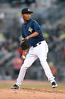 Closing pitcher Jose Moreno (26) of the Columbia Fireflies delivers a pitch and earns the save in a 3-2 win over the Augusta GreenJackets on Saturday, June 1, 2019, at Segra Park in Columbia, South Carolina. (Tom Priddy/Four Seam Images)