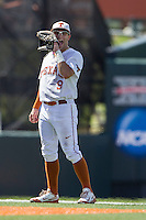 Texas Longhorns shortstop CJ Hinojosa (9) signals to his second baseman during the NCAA Super Regional baseball game against the Houston Cougars on June 7, 2014 at UFCU Disch–Falk Field in Austin, Texas. The Longhorns are headed to the College World Series after they defeated the Cougars 4-0 in Game 2 of the NCAA Super Regional. (Andrew Woolley/Four Seam Images)