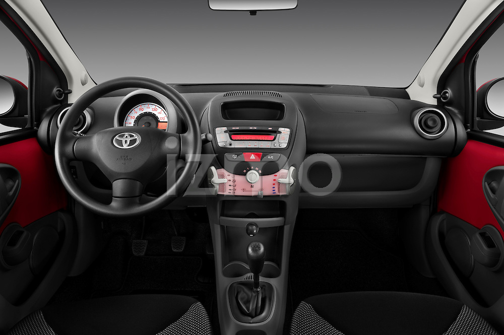 Straight dashboard view of a 2010 Toyota Aygo + 5 Door Microcar .