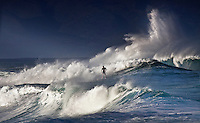 Surfer riding large winter wave at RockPile on North Shore of Oahu.