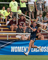 NEWTON, MA - MAY 22: Savannah Buchanan #8 of Notre Dame passes the ball during NCAA Division I Women's Lacrosse Tournament quarterfinal round game between Notre Dame and Boston College at Newton Campus Lacrosse Field on May 22, 2021 in Newton, Massachusetts.