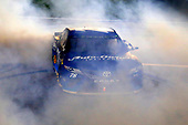 Monster Energy NASCAR Cup Series<br /> Go Bowling 400<br /> Kansas Speedway, Kansas City, KS USA<br /> Saturday 13 May 2017<br /> Martin Truex Jr, Furniture Row Racing, Auto-Owners Insurance Toyota Camry celebrates his win with a burnout <br /> World Copyright: Russell LaBounty<br /> LAT Images<br /> ref: Digital Image 17KAN1rl_5818