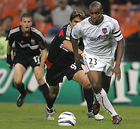 30 October,  2004. MetroStars defender Eddie Pope (23) carries the ball into the box with DC United's Jaime Moreno (99) close behind  during the 2004 MLS playoffs at RFK Stadium in Washington, DC.