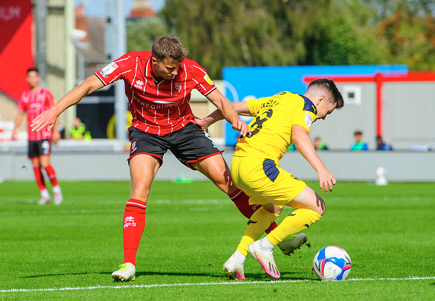 Lincoln City's James Jones vies for possession with Oxford United's Liam Kelly<br /> <br /> Photographer Chris Vaughan/CameraSport<br /> <br /> The EFL Sky Bet League One - Saturday 12th September 2020 - Lincoln City v Oxford United - LNER Stadium - Lincoln<br /> <br /> World Copyright © 2020 CameraSport. All rights reserved. 43 Linden Ave. Countesthorpe. Leicester. England. LE8 5PG - Tel: +44 (0) 116 277 4147 - admin@camerasport.com - www.camerasport.com - Lincoln City v Oxford United