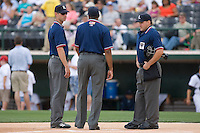 (L-R) Umpires Derek Crabill, Damien Beal and David Rackley prior to the start of the International League game between the Syracuse Chiefs and the Charlotte Knights at Knights Castle May 3, 2009 in Fort Mill, South Carolina. (Photo by Brian Westerholt / Four Seam Images)