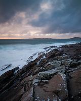 Stormy sea washes across rocky coastline, near Scarista, Isle of Harris, Scotland