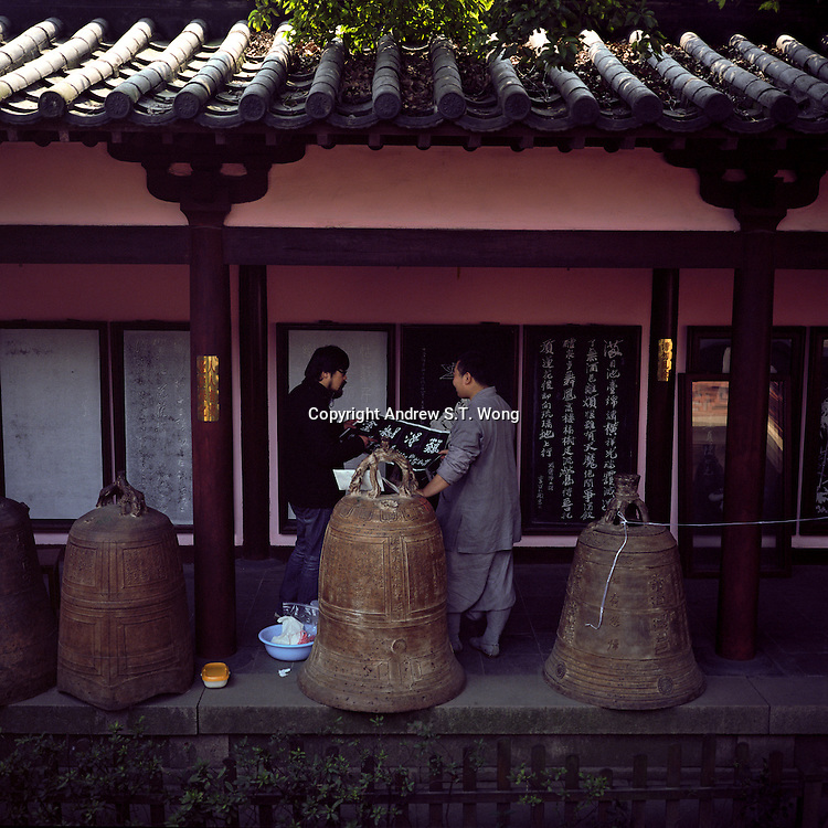 A monk discusses Buddhist inscriptions at Hanshan Temple in Suzhou, Jiangsu province, 2012. (Mamiya 6, 75mm, Kodak Ektar 100 film)