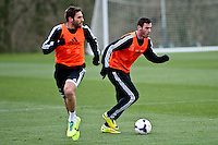Thursday 20 March 2014<br /> Pictured:( L-R ) Angel Rangel and Alvaro Vasquez<br /> Re: Swansea City Training at their Fairwood training facility, Swansea, Wales,UK