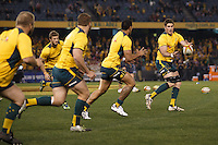 MELBOURNE, 29 JUNE 2013 - The Australian Wallabies warm up prior to the start of the Second Test match between the Australian Wallabies and the British & Irish Lions at Etihad Stadium on 29 June 2013 in Melbourne, Australia. (Photo Sydney Low / sydlow.com)