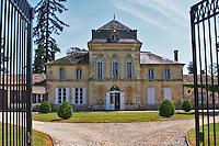 The main chateau building, renovated by Jorgensen, seen through a black iron gate Chateau de Haux Premieres Cotes de Bordeaux Entre-deux-Mers Bordeaux Gironde Aquitaine France