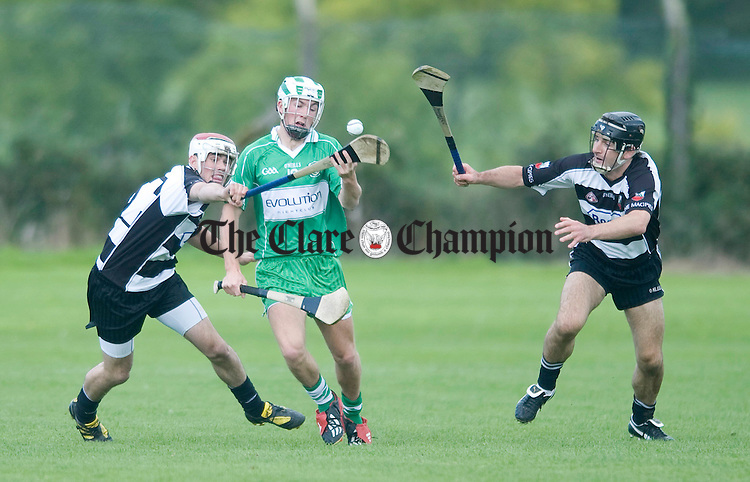 Ferghus Ryan and Eric Flynn of Clarecastle put pressure on John Guilfoyle. Photograph by Declan Monaghan