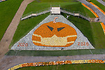 FRIDAY 9TH OCTOBER 2020<br /> <br /> Pictured: Owner Tom Nelson of  Sunnyfields Farm in Totton, Hants adds the final pumpkin to the giant artwork of a pumpkin donning a facemask, made up of over 5,000 of the vegetables which goes on display to the public for the first time tomorrow. <br /> <br /> © Jordan Pettitt/Solent News & Photo Agency<br /> UK +44 (0) 2380 458800