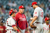 Philadelphia Phillies pitching coach Rich Dubee talks on the mound with pitcher Phillippe Aumont #48 and catcher Carlos Ruiz #51 during the Major League baseball game against the Houston Astros on September 16th, 2012 at Minute Maid Park in Houston, Texas. The Astros defeated the Phillies 7-6. (Andrew Woolley/Four Seam Images).