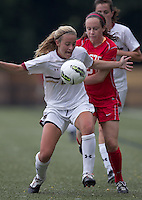 Boston College forward/midfielder Kate McCarthy (21) attempts to control the ball as Boston University midfielder Megan McGoldrick (21) defends. After 2 complete overtime periods, Boston College tied Boston University, 1-1, after 2 overtime periods at Newton Soccer Field, August 19, 2011.
