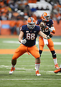 Syracuse Orange offensive guard Nick Robinson (65) blocks during a game against the Boston College Eagles at the Carrier Dome on November 30, 2013 in Syracuse, New York.  Syracuse defeated Boston College 34-31.  (Copyright Mike Janes Photography)