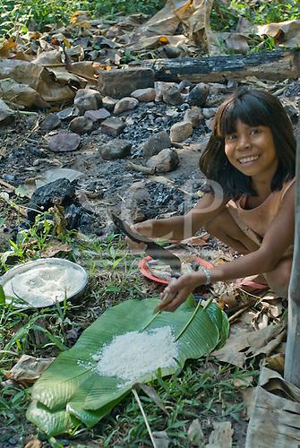 Mato Grosso State, Brazil. Aldeia Metuktire (Kayapo). Nhredjan Tapayuna preparing to cook fish and manioc (in the leaves).