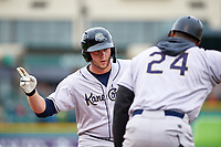 Kane County Cougars Zack Shannon (18) is congratulated by Carlos Mesa (24) after getting a hit during a Midwest League game against the Fort Wayne TinCaps at Parkview Field on May 1, 2019 in Fort Wayne, Indiana. Fort Wayne defeated Kane County 10-4. (Zachary Lucy/Four Seam Images)