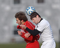 St. Lawrence forward Morgan Smith (15) and Amherst defender Ben Norton (4) battle for head ball.  NCAA Division III Sectionals. In double-overtime, Amherst College (white) defeated St. Lawrence University (red), 2-1, on Hitchcock Field at Amherst College on November 23, 2013.