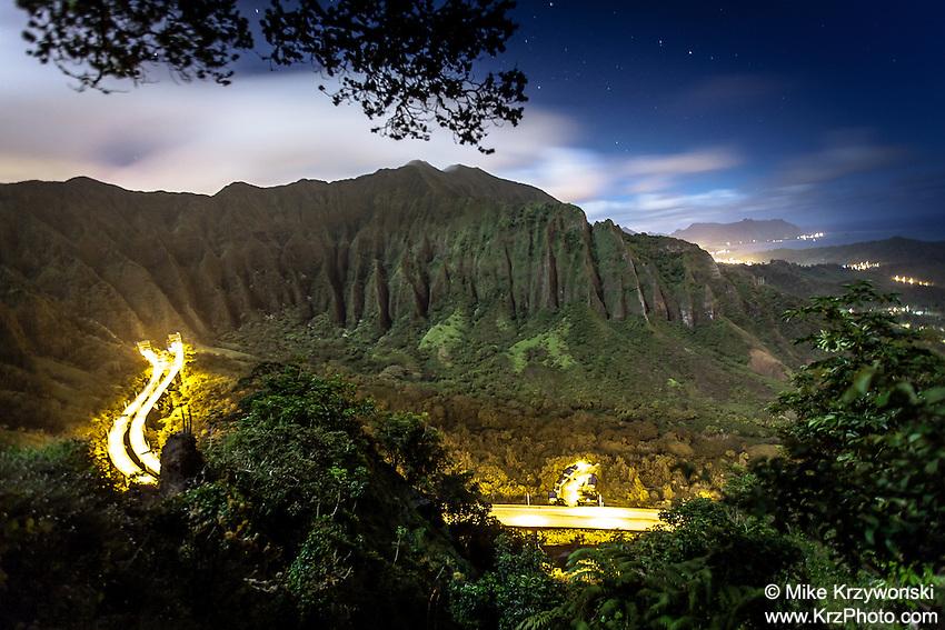 "An aerial view of the Ko'olau mountain range & H-3 freeway in Haiku valley at night from Haiku Stairs (""Stairway to Heaven"") hiking trail in Kaneohe, Oahu"